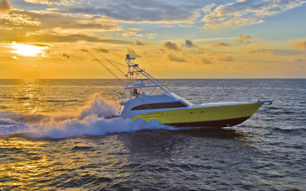 ... a Florida sunrise with a Donzi 80 Sportfishing yacht in the foreground.